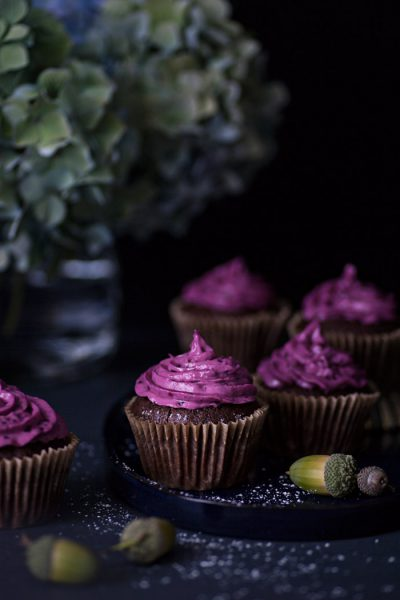 Chocolate cupcakes with blackberry frosting